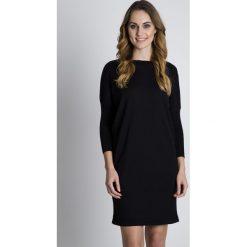 Czarna jesienna sukienka z długim rękawem BIALCON. Czarne sukienki damskie BIALCON, na jesień, z wełny, eleganckie, z długim rękawem. W wyprzedaży za 130.00 zł.