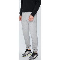 Reebok - Spodnie. Szare spodnie sportowe męskie Reebok, z bawełny. Za 179.90 zł.