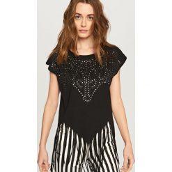 T-shirt z frędzlami - Czarny. T-shirty damskie marki DOMYOS. W wyprzedaży za 19.99 zł.