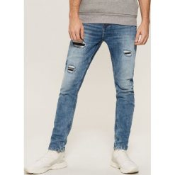 Jeansy slim - Niebieski. Niebieskie jeansy męskie House. W wyprzedaży za 89.99 zł.
