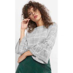 Koszulka w kratę. Szare bluzki damskie Orsay, z dzianiny, z falbankami, z długim rękawem. Za 89.99 zł.