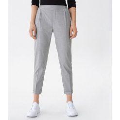 b818cd19aef276 Spodnie bonprix szary melanż - Spodnie materiałowe damskie marki ...