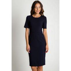 Dopasowana granatowa sukienka z krótkim rękawem BIALCON. Niebieskie sukienki damskie BIALCON, biznesowe, z krótkim rękawem. Za 299.00 zł.