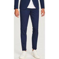Spodnie garniturowe slim fit - Granatowy. Eleganckie spodnie męskie marki Giacomo Conti. Za 149.99 zł.