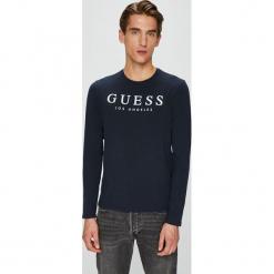 Guess Jeans - Longsleeve. Czarne bluzki z długim rękawem męskie Guess Jeans, z aplikacjami, z bawełny, z okrągłym kołnierzem. W wyprzedaży za 99.90 zł.