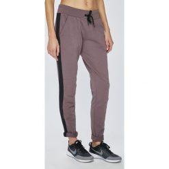 Reebok - Spodnie. Szare spodnie sportowe damskie Reebok, z bawełny. W wyprzedaży za 219.90 zł.