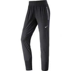 """Spodnie sportowe """"Flex Swift"""" w kolorze czarnym. Spodnie sportowe damskie Nike Women. W wyprzedaży za 260.95 zł."""