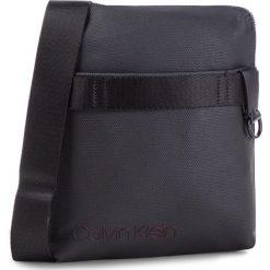 Saszetka CALVIN KLEIN - City Active Flat Crossover K50K503918 910. Czarne saszetki męskie Calvin Klein, ze skóry ekologicznej, młodzieżowe. Za 399.00 zł.