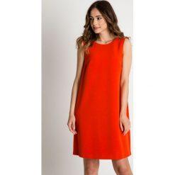Sukienka w kolorze pomarańczowym na grubych ramiączkach BIALCON. Brązowe sukienki damskie BIALCON, wizytowe, na ramiączkach. Za 90.00 zł.