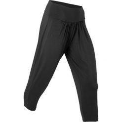 Spodnie sportowe haremki funkcyjne, dł. 7/8 bonprix czarny. Czarne spodnie dresowe damskie bonprix. Za 37.99 zł.