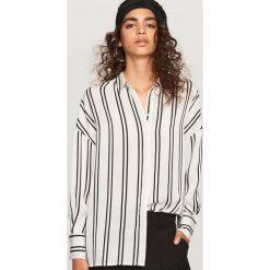Koszula w paski - Czarny. Koszule damskie marki SOLOGNAC. W wyprzedaży za 39.99 zł.