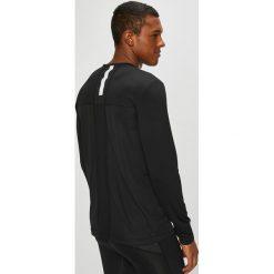Calvin Klein Performance - Longsleeve. Czarne bluzki z długim rękawem męskie Calvin Klein Performance, z dzianiny, z okrągłym kołnierzem. Za 199.90 zł.