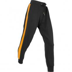 Spodnie dresowe, długie bonprix czarny. Czarne spodnie dresowe damskie bonprix, w paski, z dresówki. Za 99.99 zł.