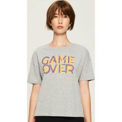 T-shirt Game over - Jasny szar. T-shirty damskie marki DOMYOS. W wyprzedaży za 14.99 zł.